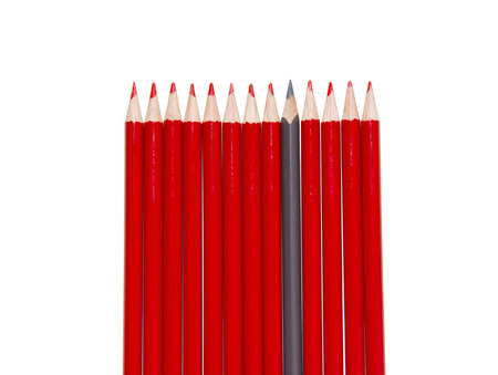 Red Pencils and black one, isolated Stock Photo