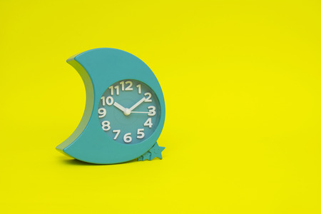 clock isolated on the yellow Imagens - 65288312