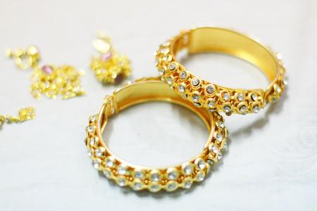 Wedding gold bracelets isilated Stock Photo