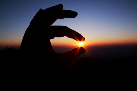 handsign: pick hand sign silhouette at sunrise