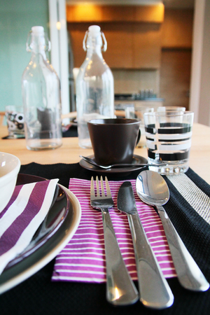 dinning room: table set in modern dinning room at home Stock Photo