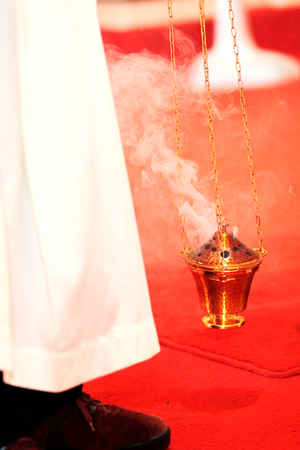 high priest: traditional incense gold bowl of wedding day in church Stock Photo