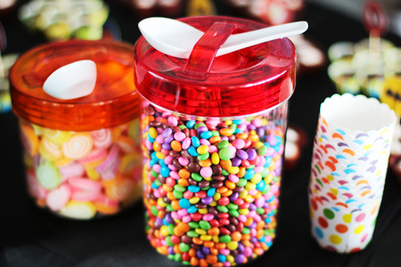 sugary: Various sugary candy in a glass jar Stock Photo
