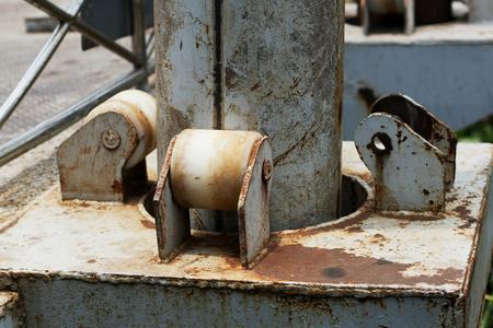 grabber: Part of old metal column of poles
