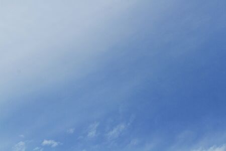 nebulosity: soft white clouds against blue sky Stock Photo