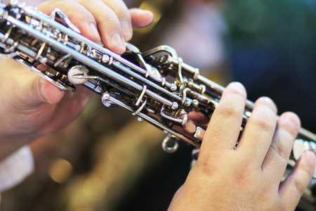 soloist: Musician playing saxophone, close-up