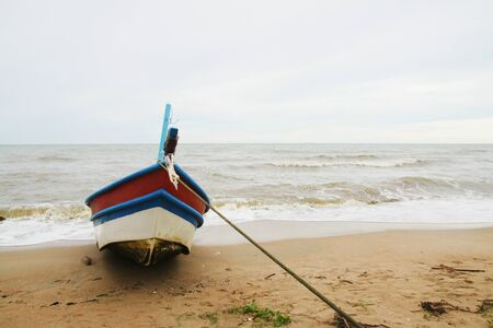 fishing boat seen ashore in Thailand