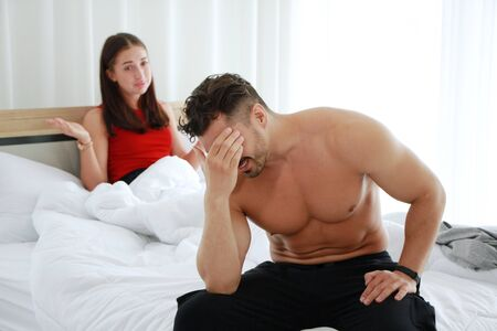 Caucasian lover Couple on the bed unhappy in having sex and have problems in relationship of married life. Erectile Dysfunction concept.