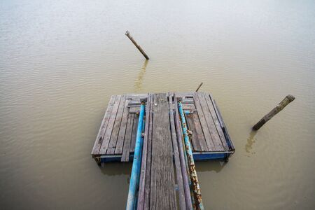 Wood Pier and Stump in the river at countryside in Thailand 版權商用圖片