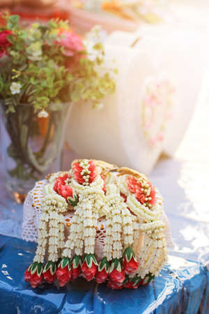 Flower garlands on a gold tray in tradition Thai wedding ceremony day. Jasmine garland.