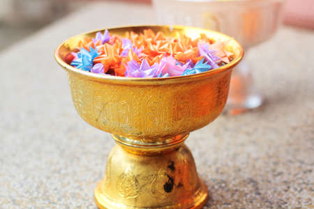 Colorful of Ribbon flowers on gold Tray for Ordination ceremony in buddhist Thai monk.