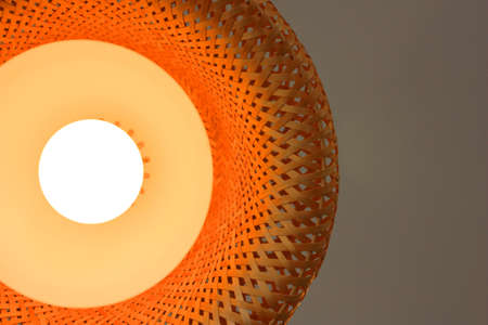 Rattan lamp hanging on ceiling.Interior and lighting design