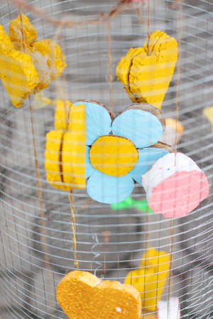 Yellow foam heart shapes hanging in Wire cage Decorate in wedding love garden. Valentines day concept.