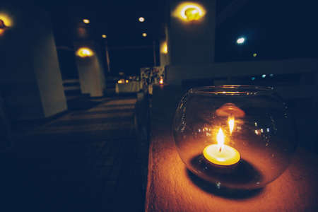 Candle light in Round glass decoration on white cloth for wedding and valentine day