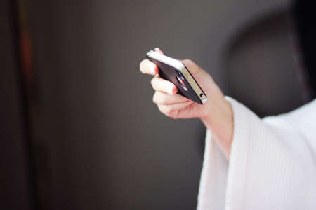 Woman hand holding cell phone in bussiness concept