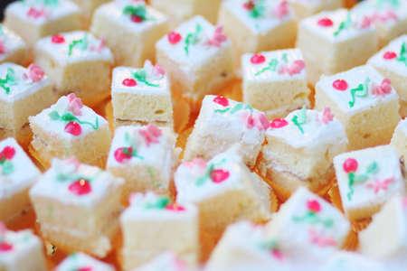 Homemade Square white cake  cream cubes dessert decorated on buffet table 版權商用圖片