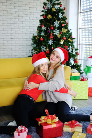 Smiling of Teenage. Caucasian couple girls friends hugging and happy with big Gift boxes in Christmas party. Life style of lesbian on holiday concept.