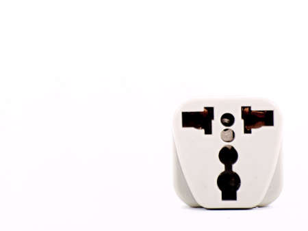 Universal Power Outlet Adapter on white background photo