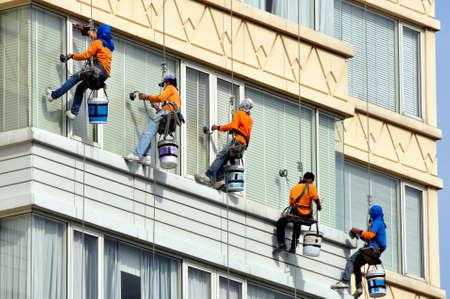 men team washes skyscrapers facade Stock Photo
