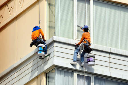 window cleaning: two men washes skyscrapers facade