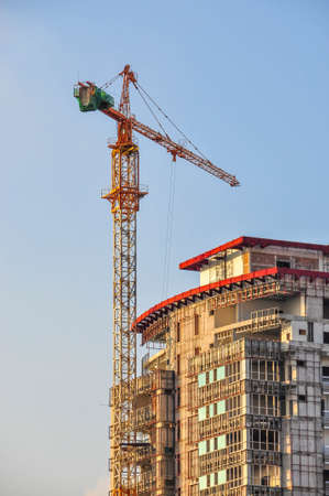 Building crane and building under construction photo