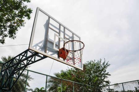 high school basketball: A basketball hoop on the street basketball court