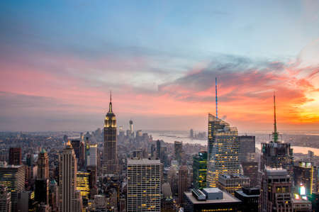 New York City skyline with urban skyscrapers at sunset photo