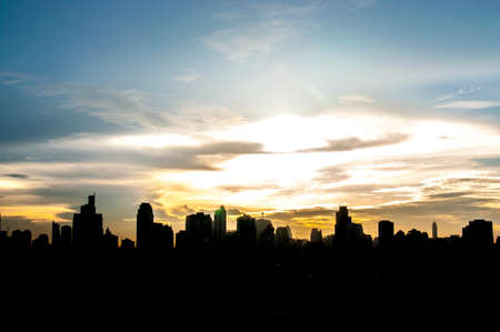 Sunset city scenery with sun and buildings