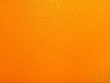 Closeup of orange leather background   photo