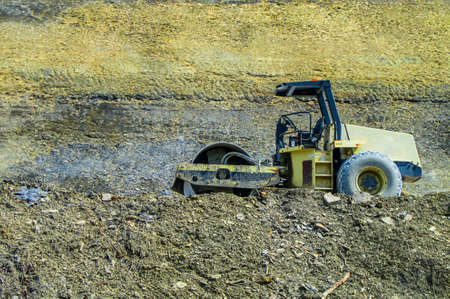 Construction site with yellow tractors  photo
