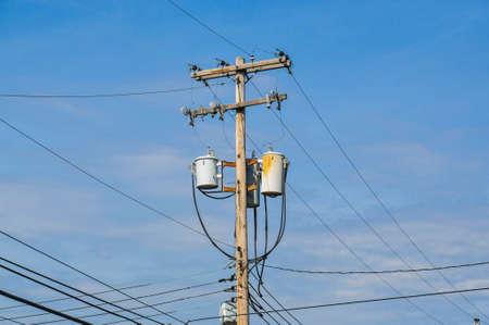 Electric transformer on blue sky photo