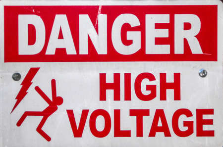 stating: a sign stating of a high voltage danger  Stock Photo