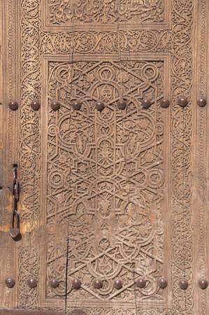 Ancient wooden door in Khiva, Uzbekistan