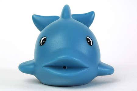 ballena pl�stica azul del juguete en el fondo blanco Foto de archivo - 762086