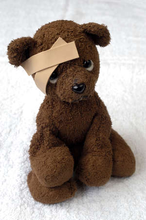 ouch: teddy-bear with a bandage