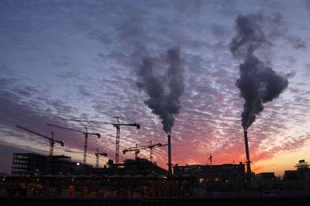 Factory smoking in sunset sky photo