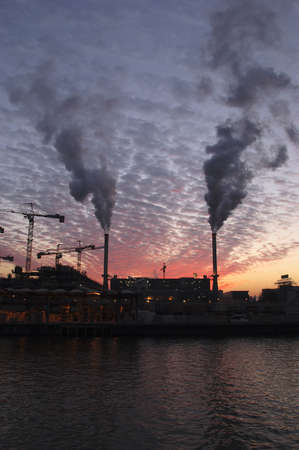 Factory smoking in sunset sky Stock Photo - 782468