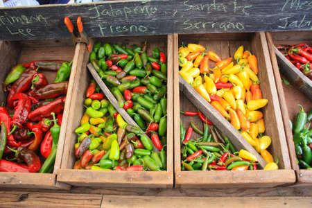 boxed: Assorted peppers for sale in a farmers market Stock Photo