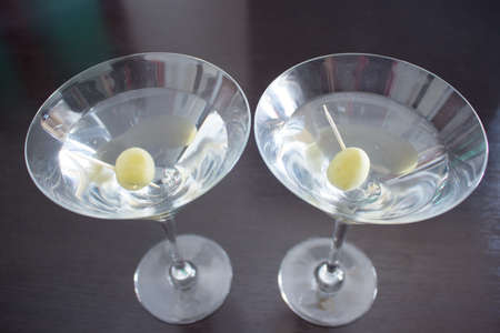 Two martini cocktails with olives