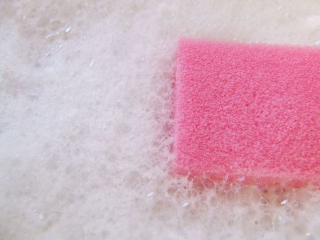 Pink Sponge In White Bubbles Stock Photo
