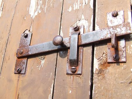 Old rusty latch on a shed door