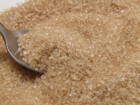 some unrefined demerara sugar (brown) , close up details and texture