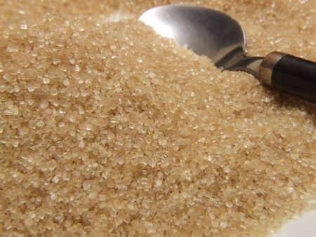 unrefined: some unrefined demerara sugar (brown) , close up details and texture