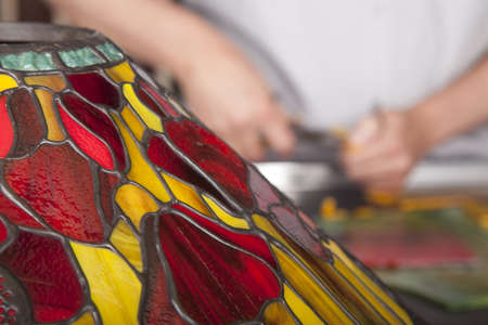 Man is making tiffany lamps