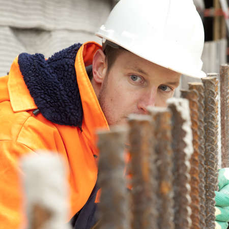 Manual worker looking at construction, road construction Stock Photo - 12048544