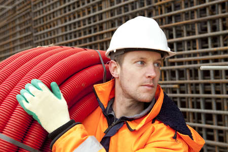 Manual worker with helmet looking at foundation Stock Photo - 12155361