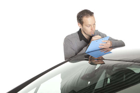 Insurance claim, expert at work Stock Photo