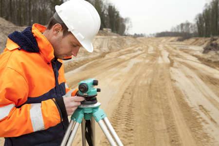 Land surveyor working on a construction site.
