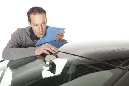 Male insurance agent making notes Stock Photo