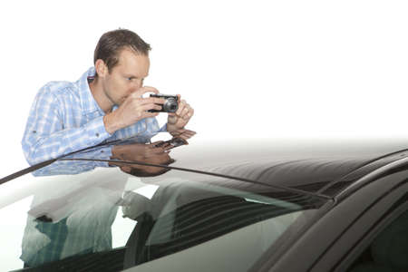 damaged car: Male insurance agent taking picture Stock Photo